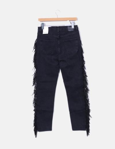 Jeans negro pitillo con flecos