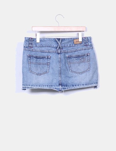 Mini falda denim con rotos
