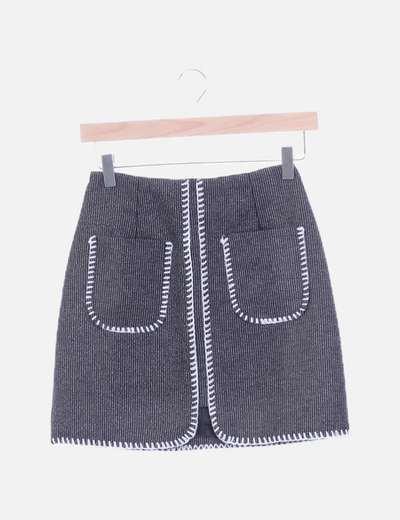 Mini falda gris jaspeada bolsillos