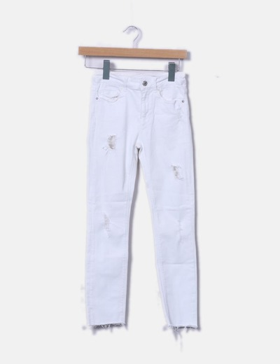 Jeans denim blanco con rotos