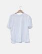 Camiseta blanca detalle flor H&M