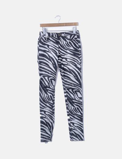 Pantalón denim pitillo print cebra