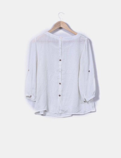 Blusa blanca con botonadura trasera