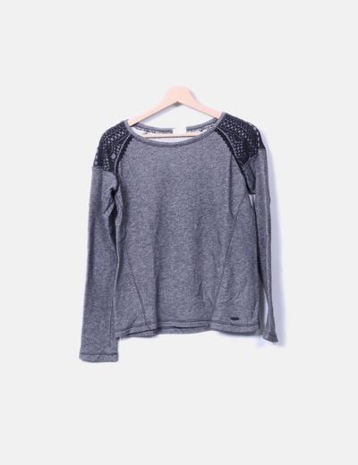Suéter gris jaspeado con encaje Rip Curl