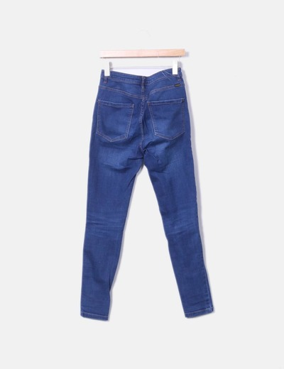 Pantalon denim con rotos