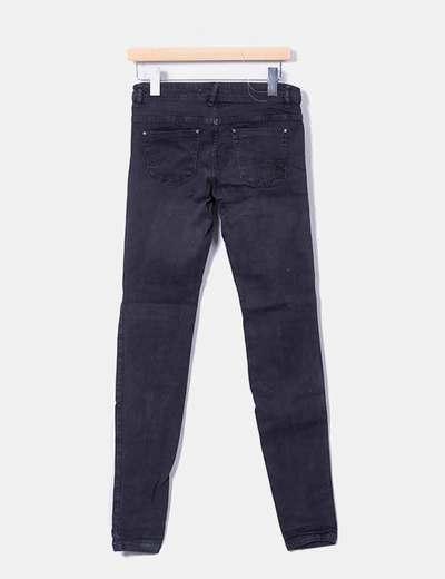 Pantalon pitillo con roturas gris