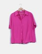 Camisa rosa fucsia detalle volante C&A