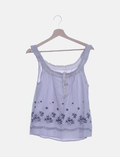 Blusa de rayas con bordado floral