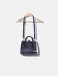 Bolso blanco y negro con cadena Zara