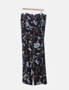 2136d45fda5 Pantalón fluido negro estampado floral Elogy