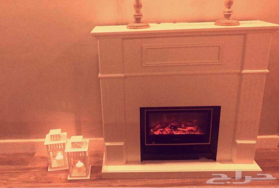 مدفئة بديكور خشبي