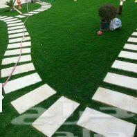 فني حدائق ومصمم شلالات ونوافير وجمع العشب