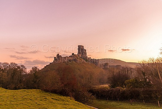 Pastel colours over Corfe castle sunrise