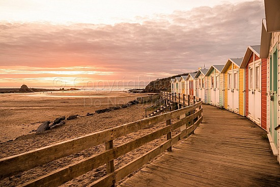 Gold sunset over summerleaze beach huts