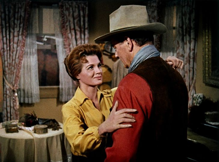 Angie Dickinson with John Wayne in Rio Bravo