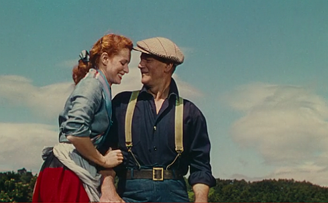 Maureen O'Hara whispers to John Wayne in The Quiet Man