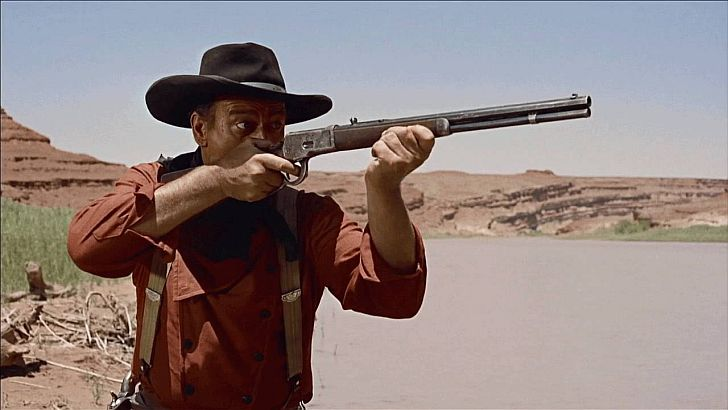 John Wayne in The Searchers with his Winchester 92