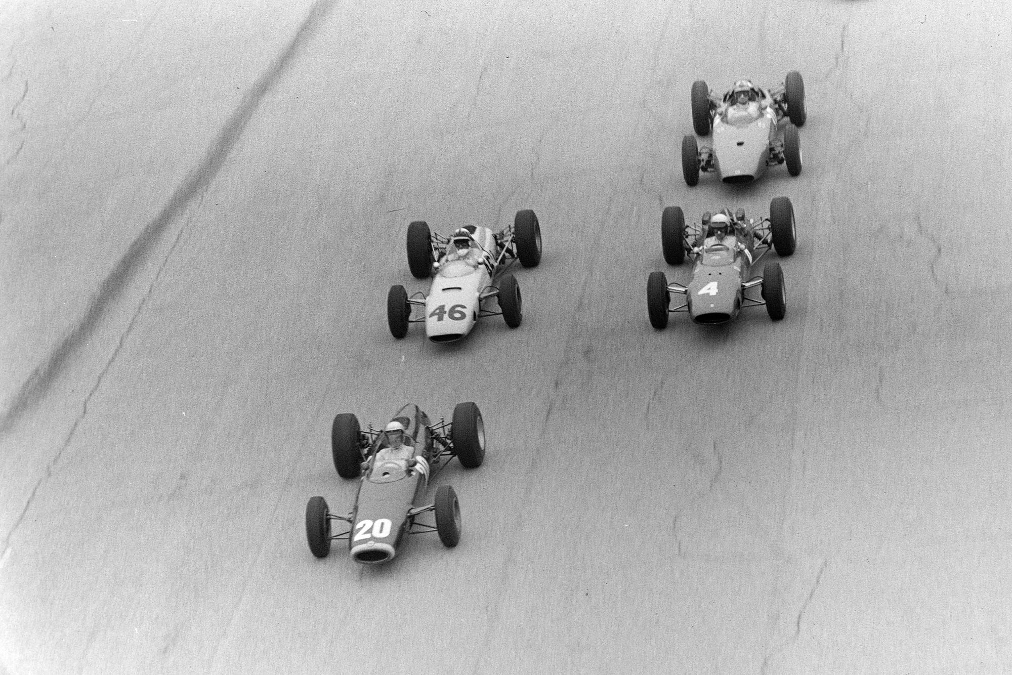 Richie Ginther, BRM P261, leads, while Innes Ireland, BRP 2 BRM, battles with Lorenzo Bandini, Ferrari 158.