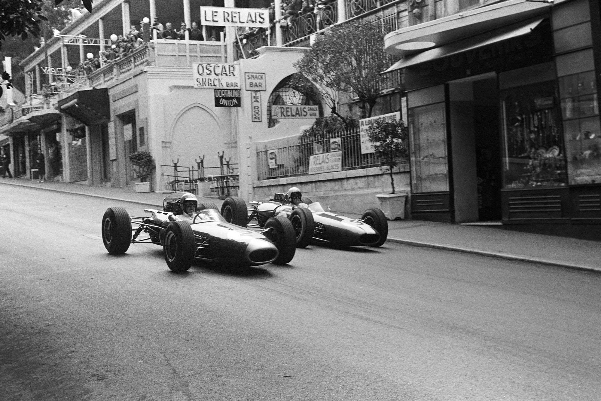 Denny Hulme, Brabham BT7 Climax, battles with Bob Anderson, Brabham BT11 Climax.