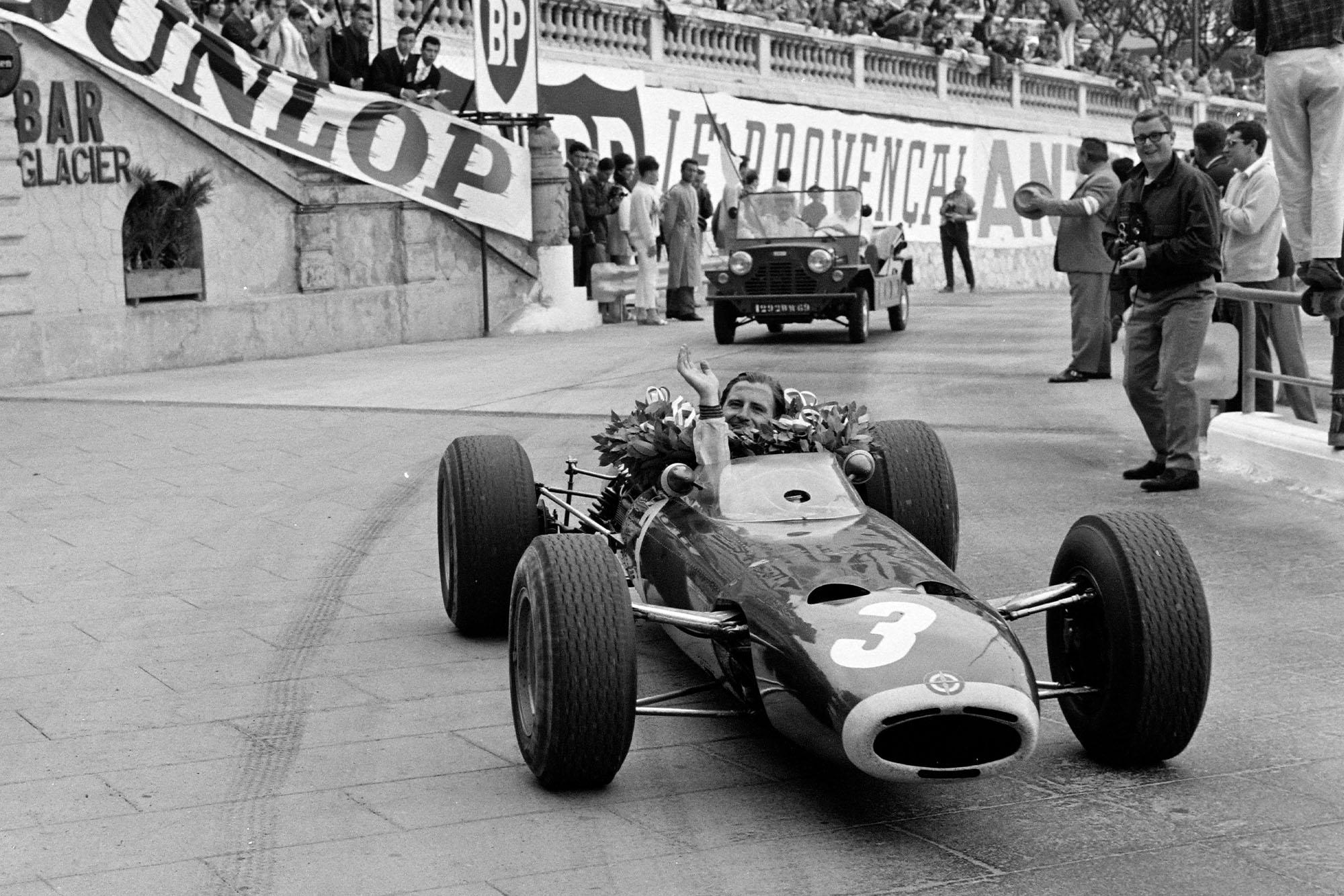 Race winner Graham Hill, BRM P261, drives a victory lap.