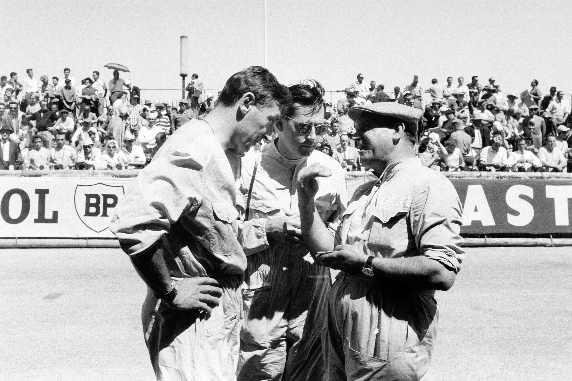 Roy Salvadori and Jack Brabham talk before 1958 Monaco Grand Prix.
