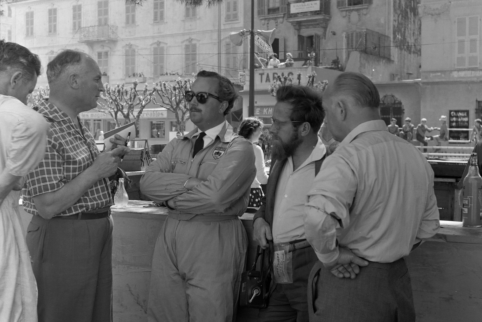 Colin Chapman talks with Denis Jenkinson at the 1958 Monaco Grand Prix