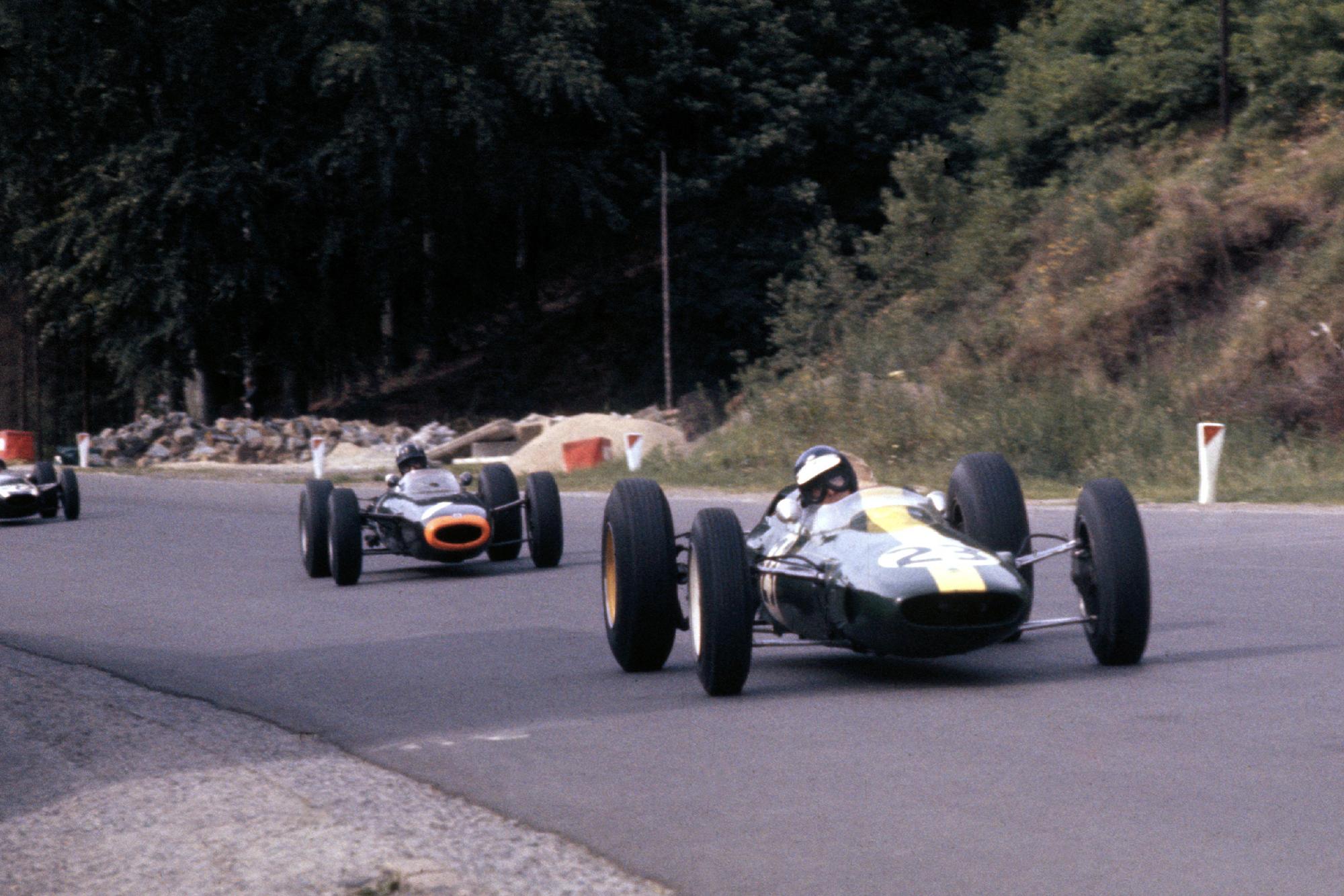 Jim Clark, Lotus 25 Climax, leads Graham Hill, BRM P261.