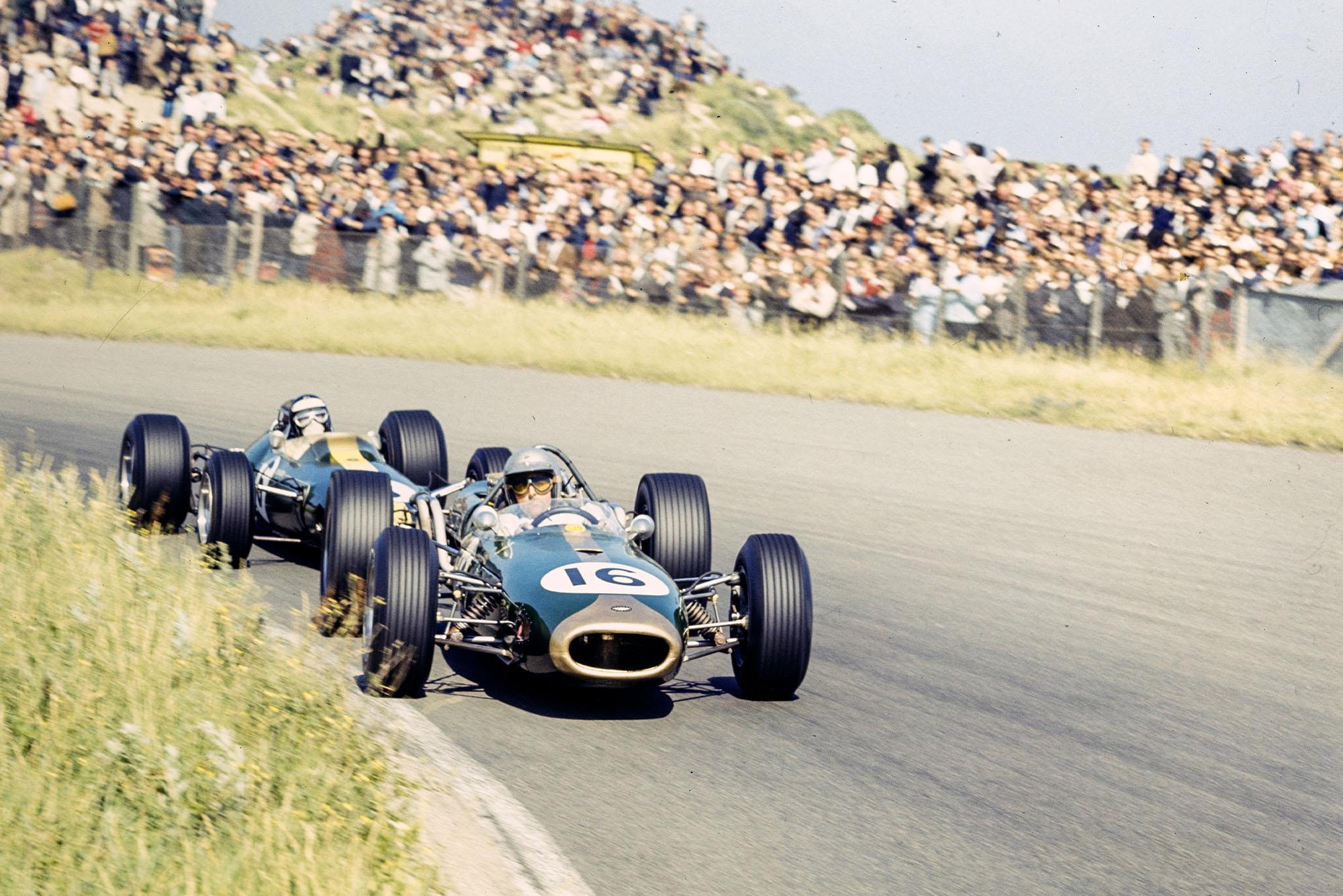 Jack Brabham, Brabham BT19 Repco leads Jim Clark, Lotus 33 Climax.