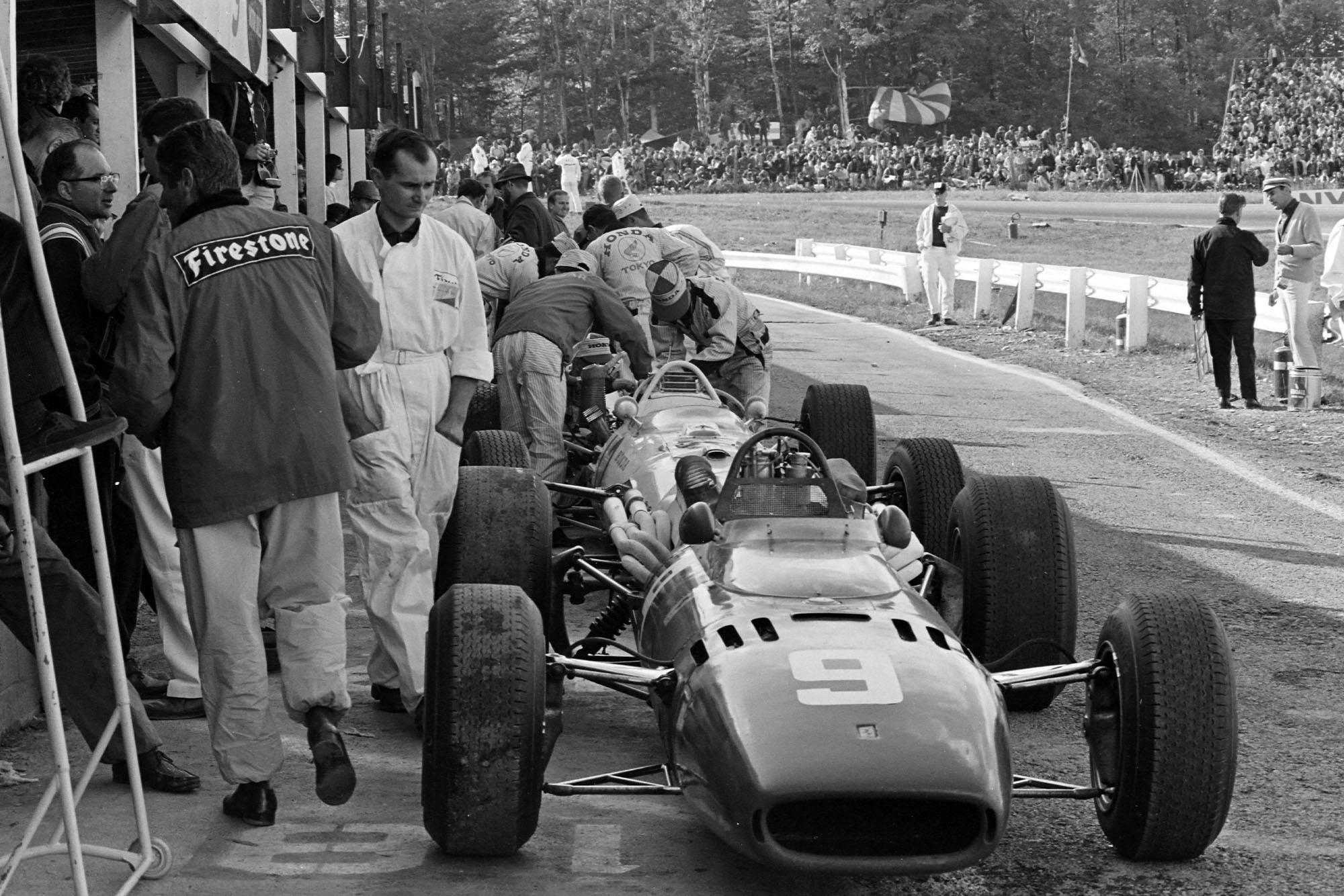 Lorenzo Bandini's Ferrari 312 in the pit lane.