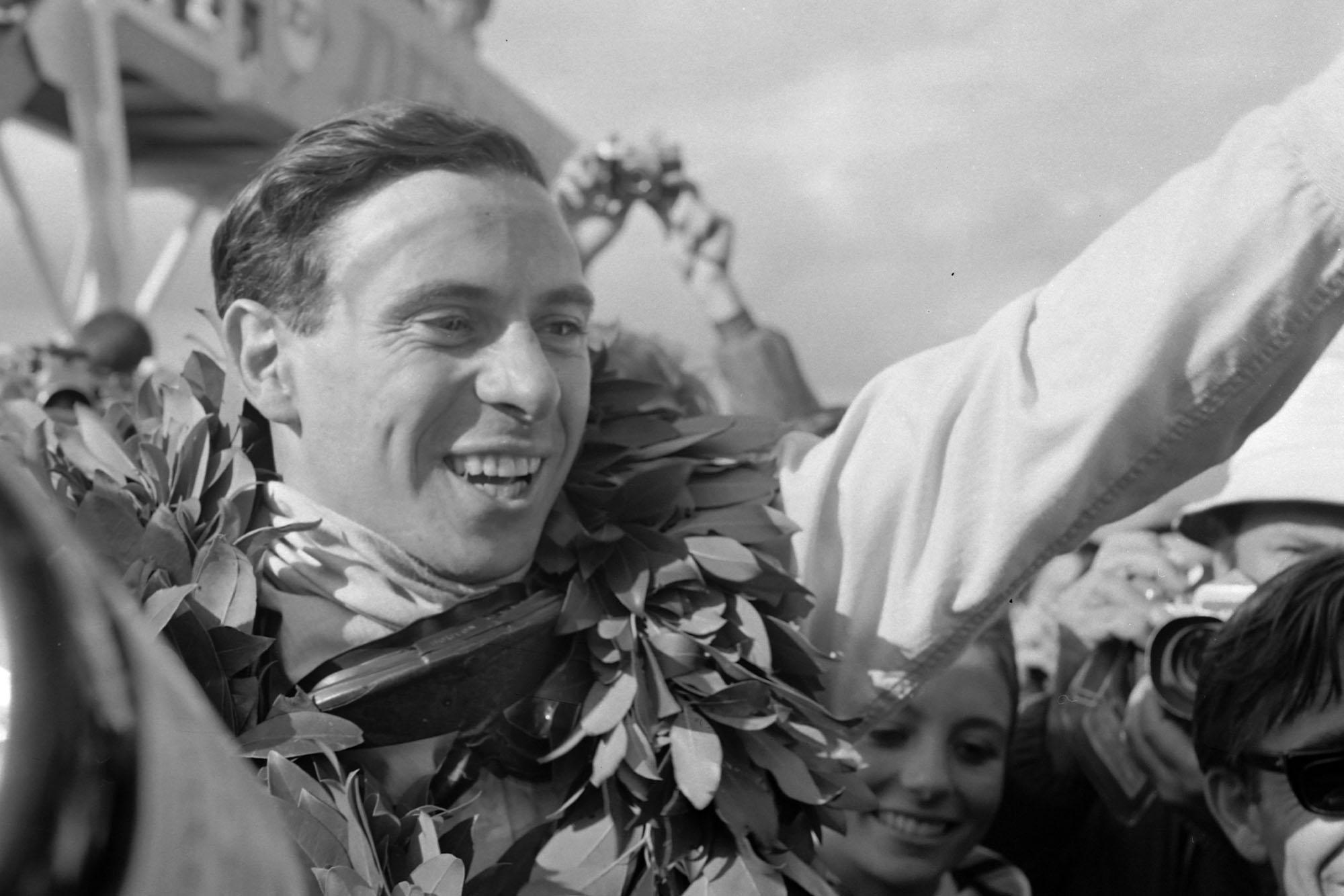 Race winner Jim Clark celebrates victory in the pit lane.
