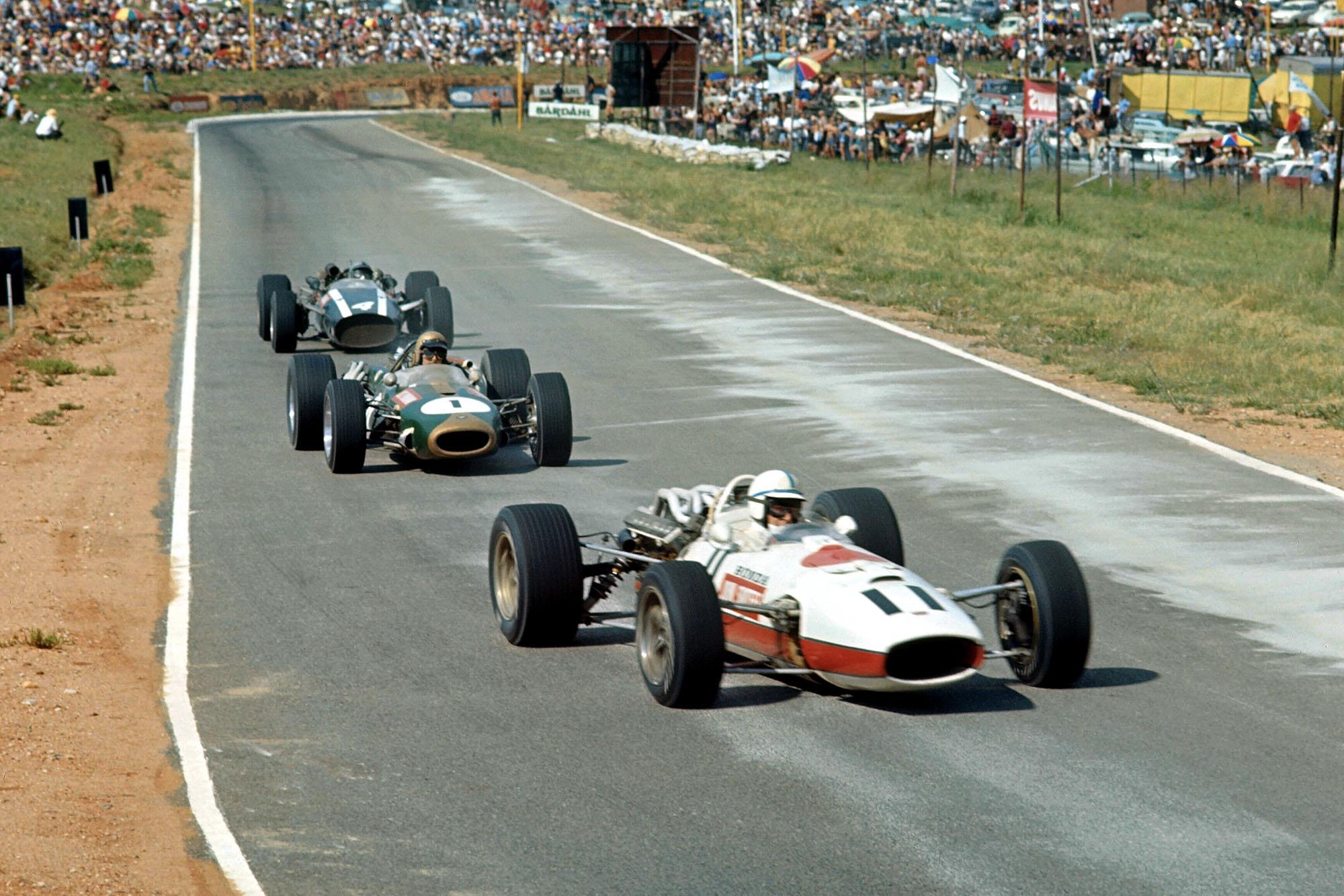 John Surtees (GBR) Honda RA273, leads Jack Brabham (AUS) Brabham Repco BT20, and eventual winner Pedro Rodriguez (MEX) Cooper Maserati T81.