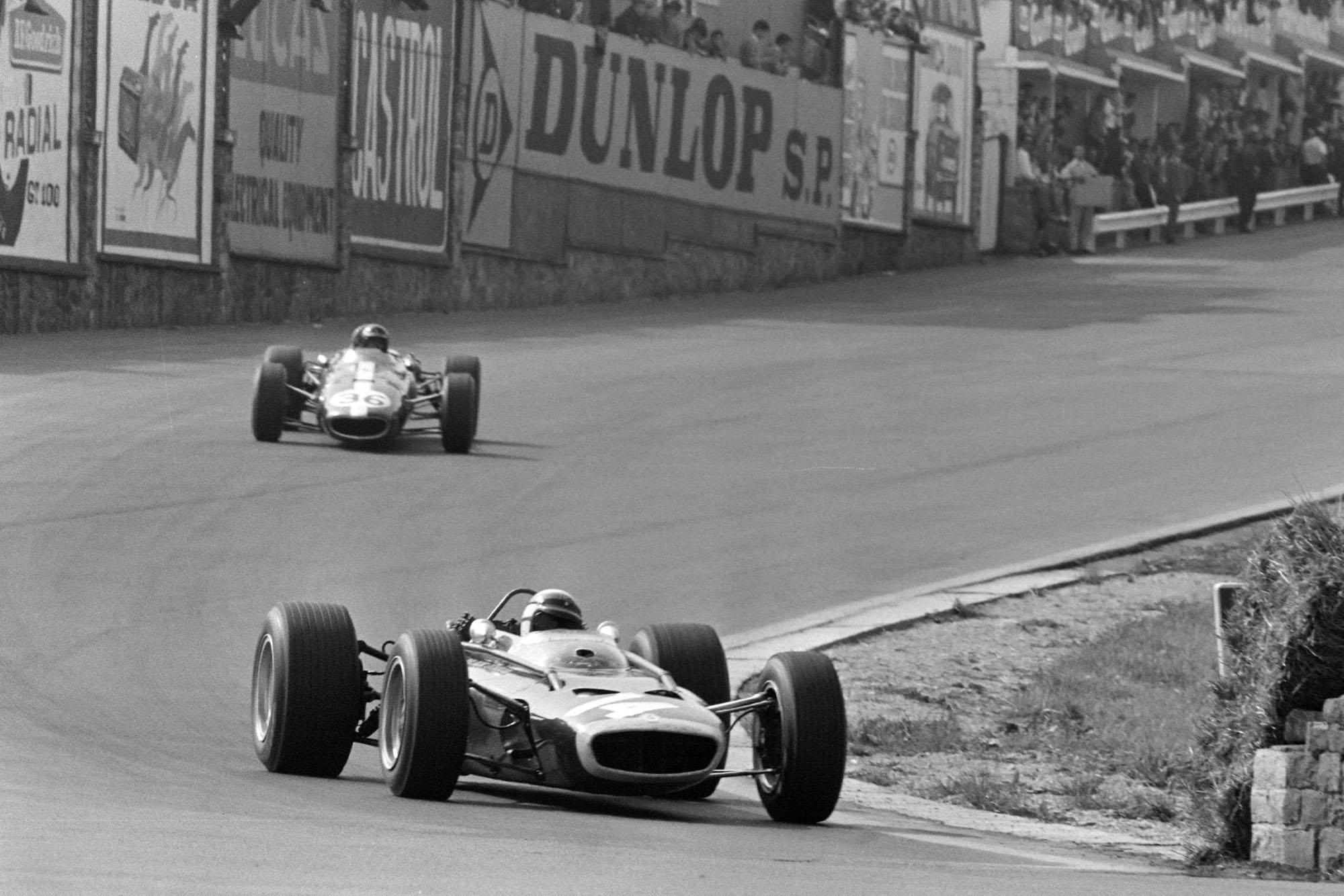 Jackie Stewart, BRM P83, leads Dan Gurney, Eagle T1G Weslake.