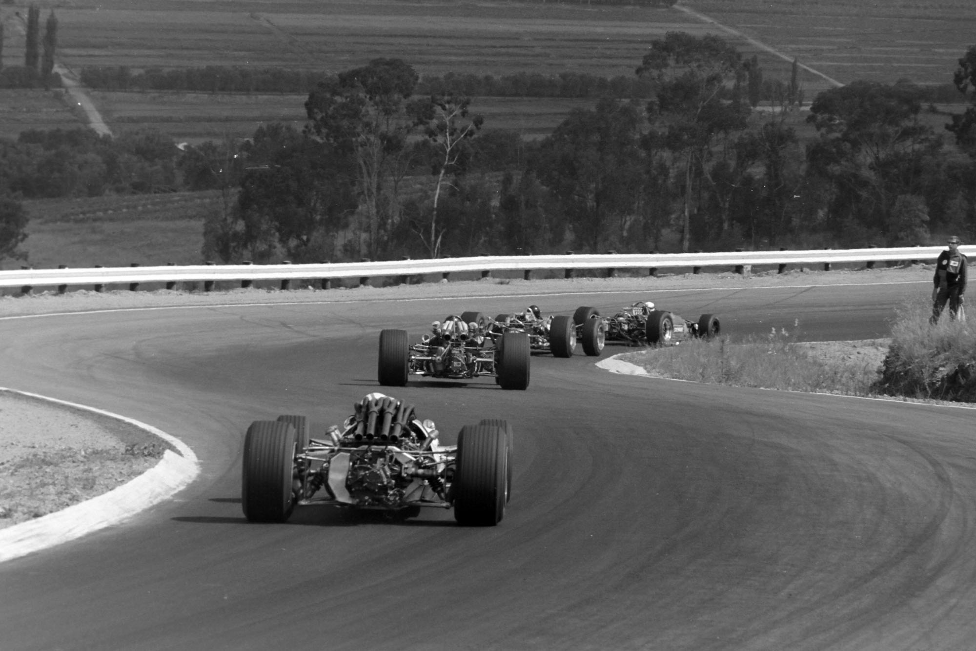 Jackie Stewart, Matra MS9 Ford, leads Jim Clark, Lotus 49 Ford, and Jochen Rindt, Brabham BT24 Repco, at the start.