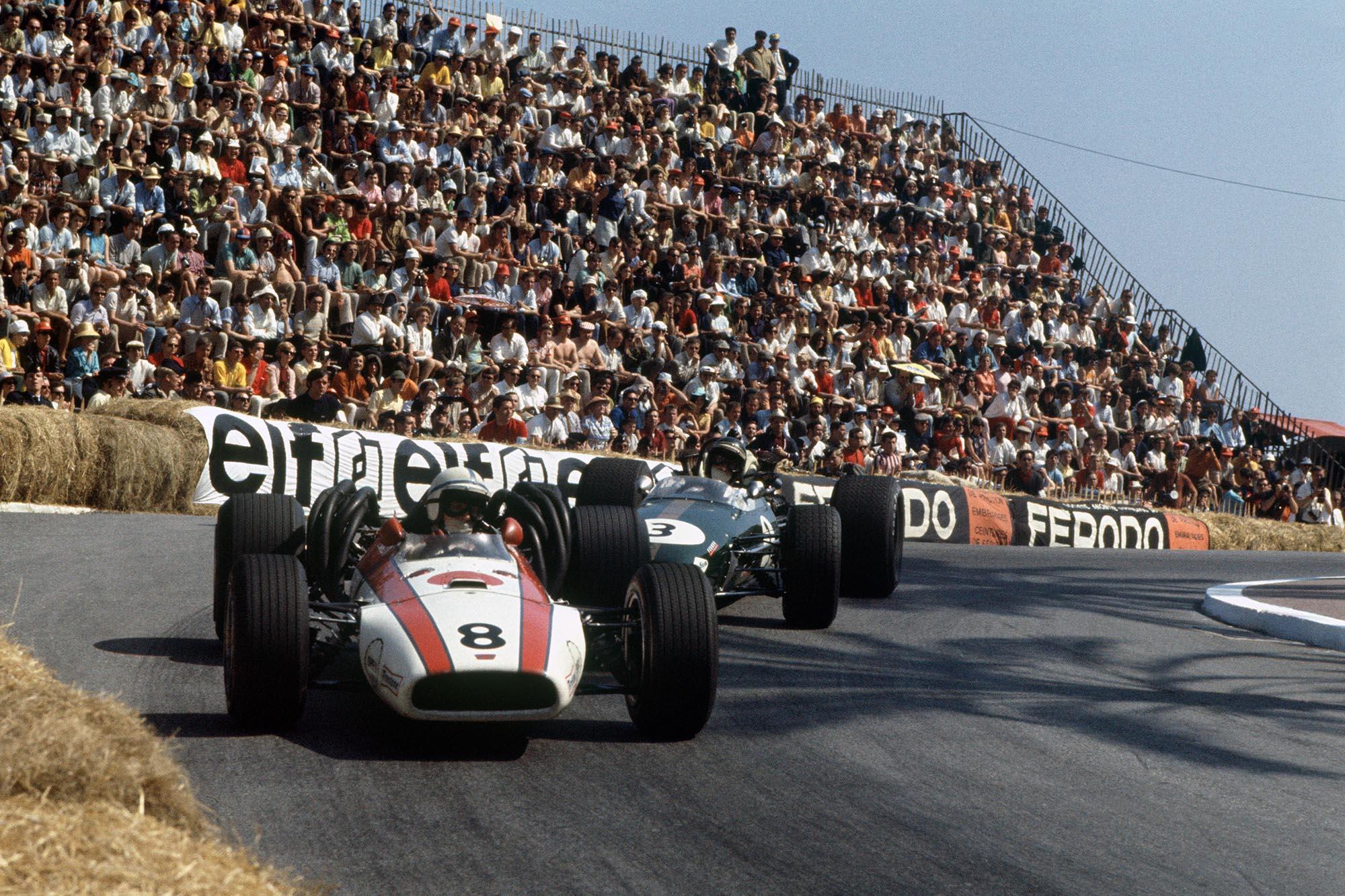 John Surtees (Honda RA301), retired, leads Jochen Rindt (Brabham BT24-Repco), retired, action.