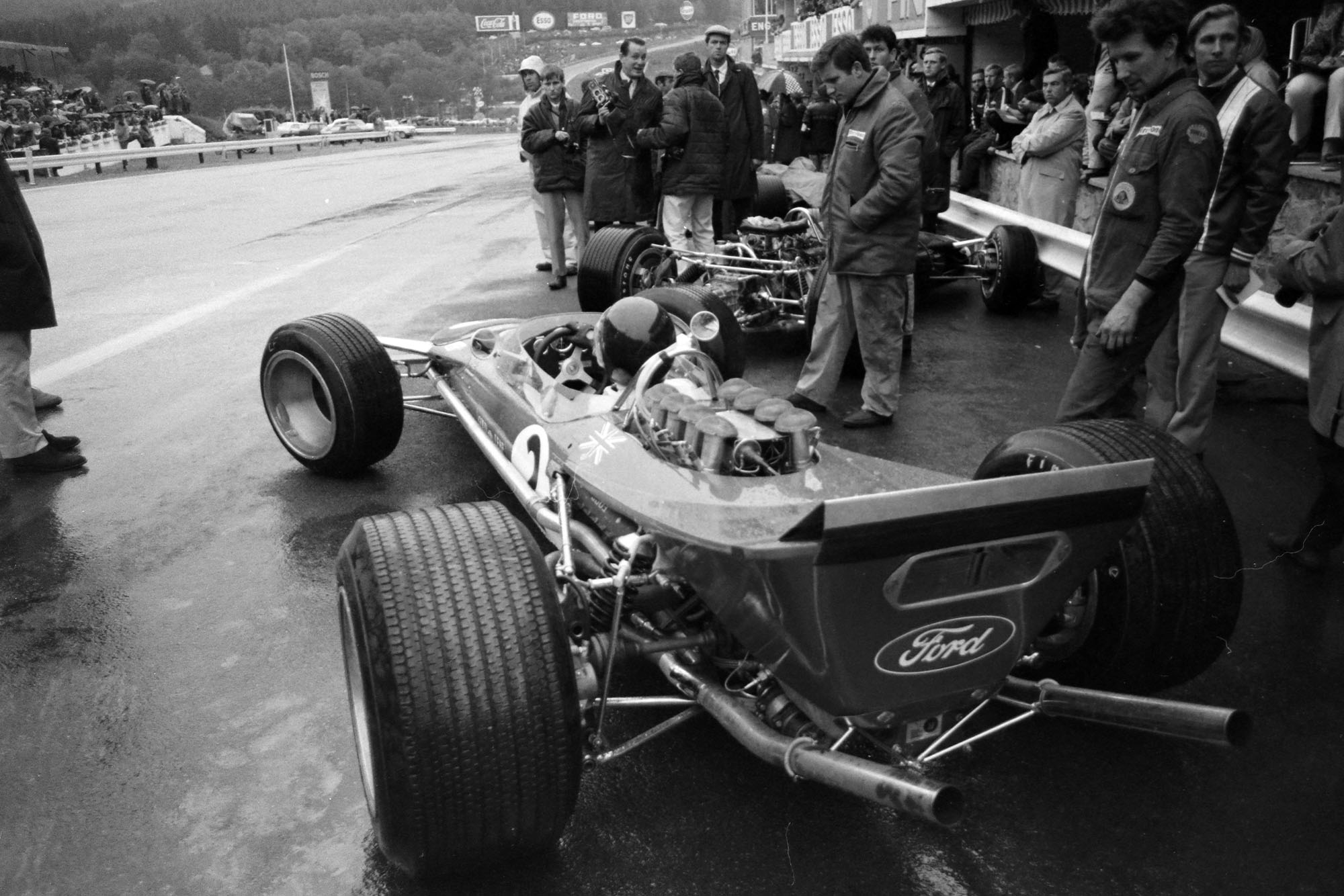 Jackie Oliver, Lotus 49B Ford, in the pit lane.