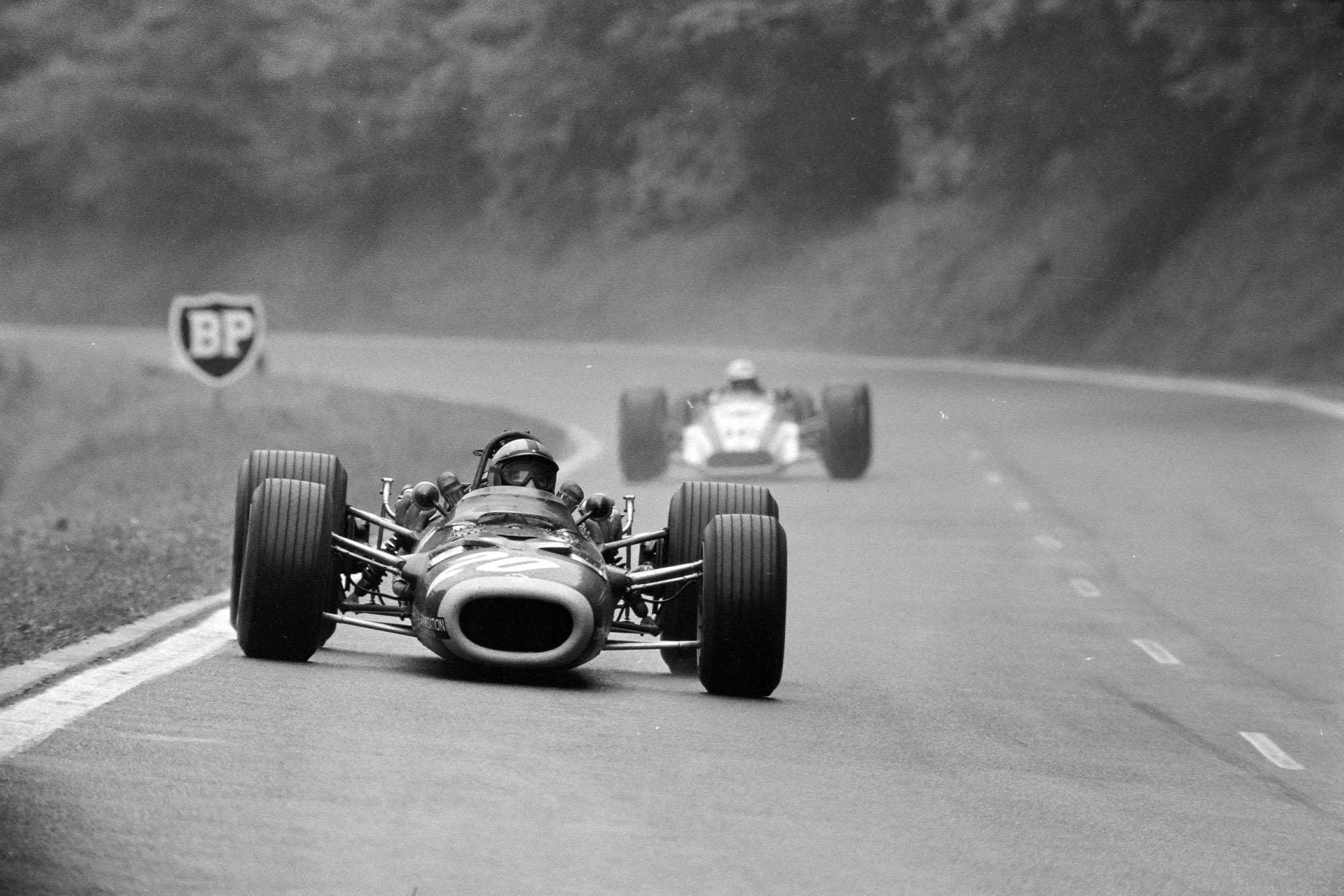 Pedro Rodriguez, BRM P133, leads John Surtees, Honda RA301.