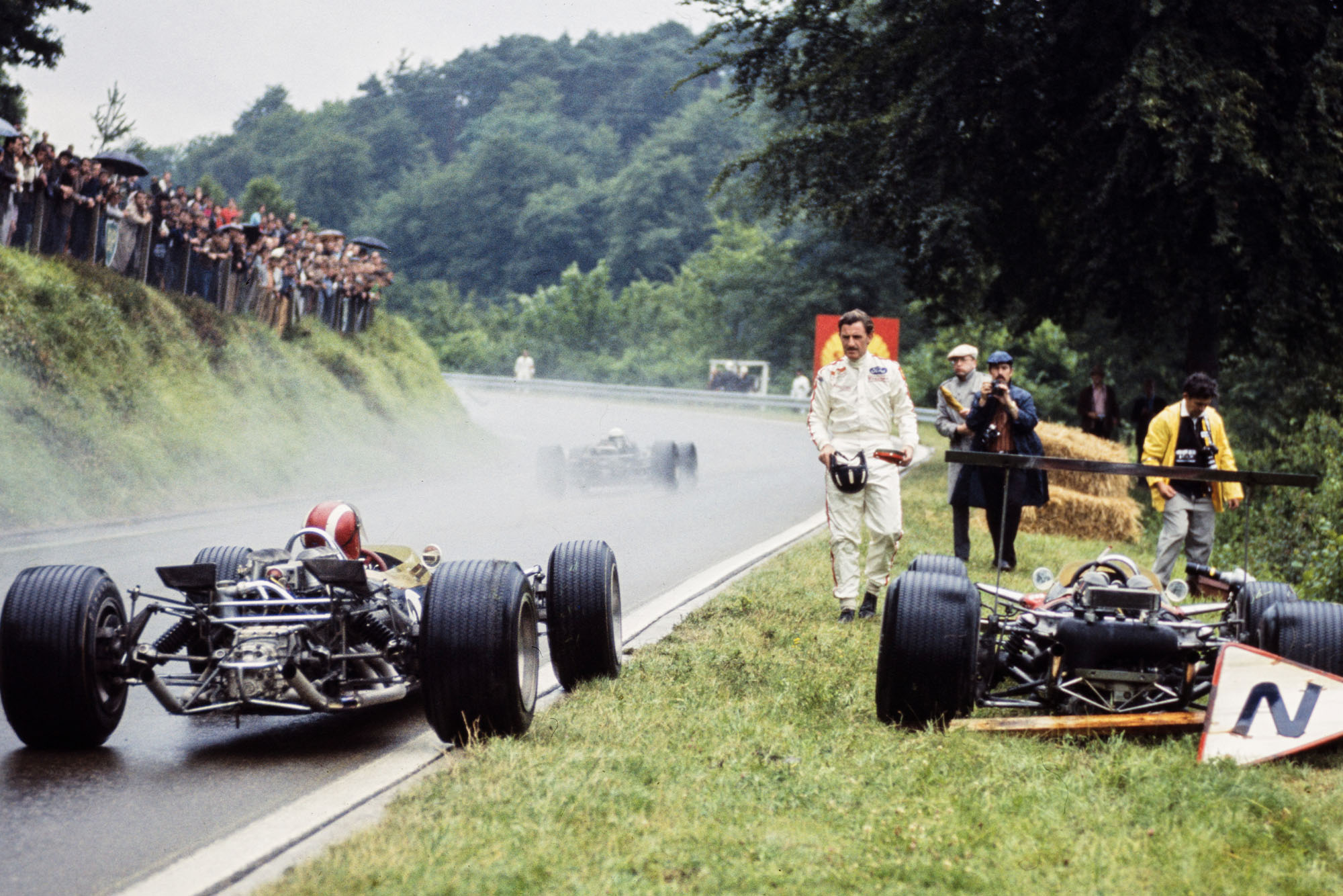 Jo Siffert, Lotus 49 Ford, pulls to the side of the track alongside retired Graham Hill, Lotus 49B Ford.