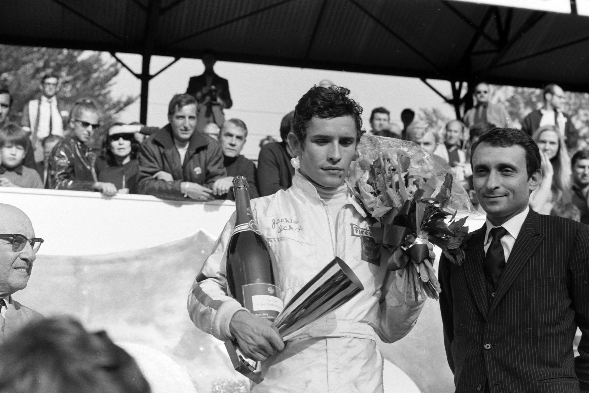 Jacky Ickx, 1st position, on the podium.