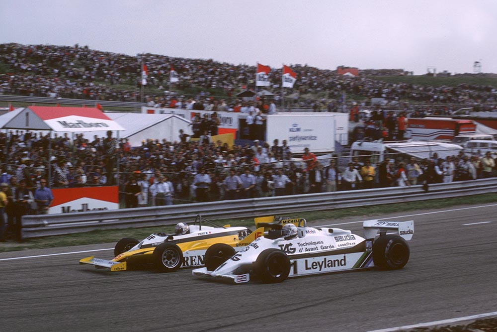 Winner Alain Prost Renault RE30, dives inside Alan Jones Williams FW07, to take the lead.