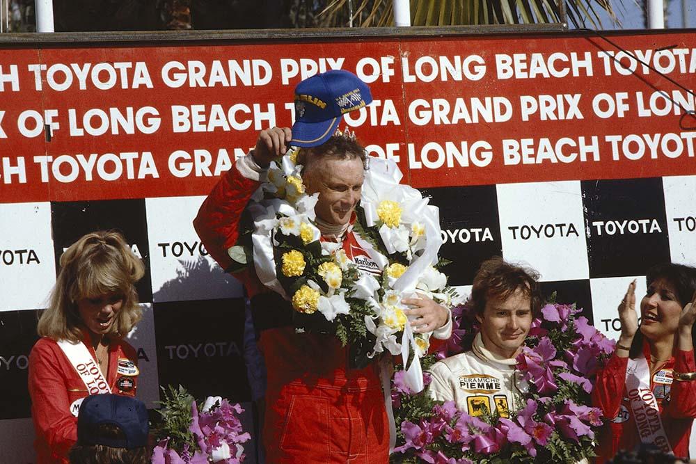 Winner Niki Lauda and 3rd place Gilles Villeneuve on the podium.