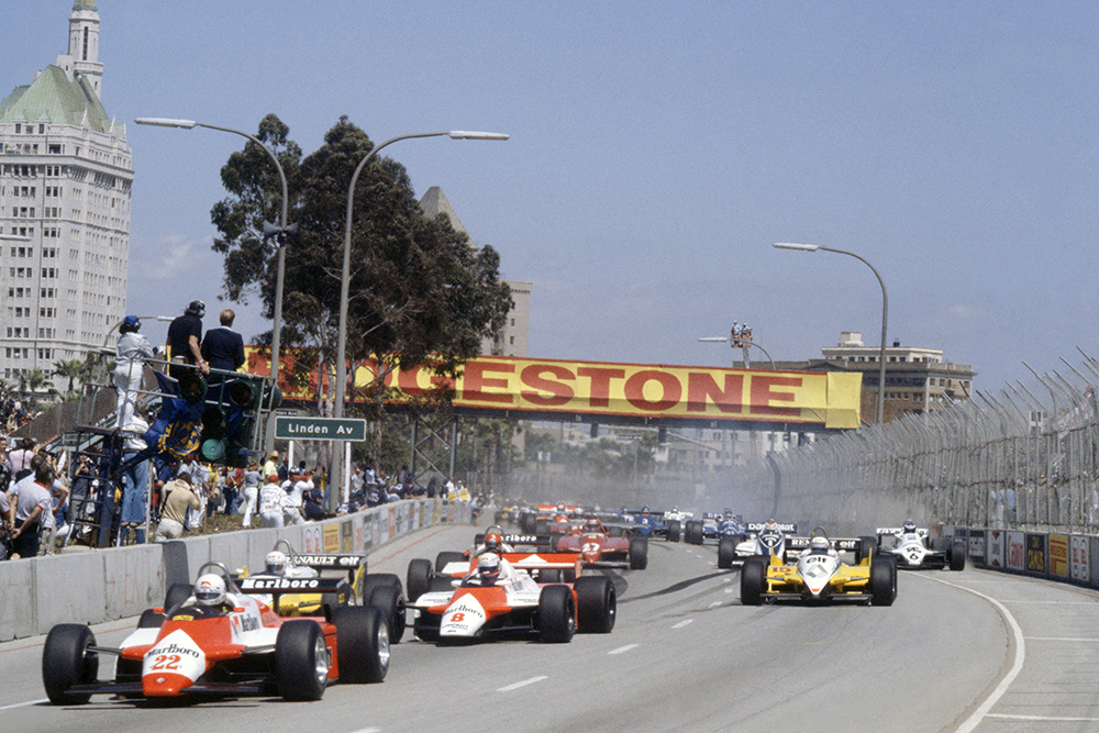 Andrea de Cesaris (Alfa Romeo 182) leads Niki Lauda (McLaren MP4/1B-Ford Cosworth), Rene Arnoux, Alain Prost (both Renault RE30B), Bruno Giacomelli (Alfa Romeo 182), Gilles Villeneuve (Ferrari 126C2), Nelson Piquet (Brabham BT49D-Ford Cosworth) and Keke Rosberg (Williams FW07C-Ford Cosworth) at the start.