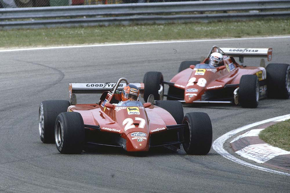 Gilles Villeneuve leads teammate Didier Pironi (Both Ferrari 126C2's). They finished in 2nd and 1st positions respectively.