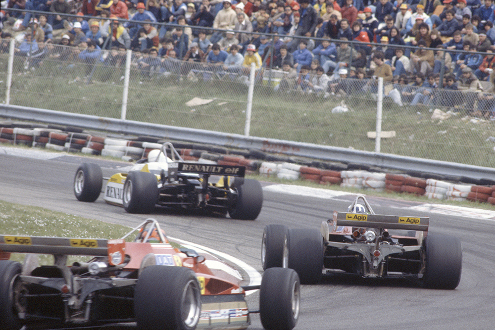 Rene Arnoux (Renault RE30B) leads Didier Pironi and Gilles Villeneuve (both Ferrari 126C2).