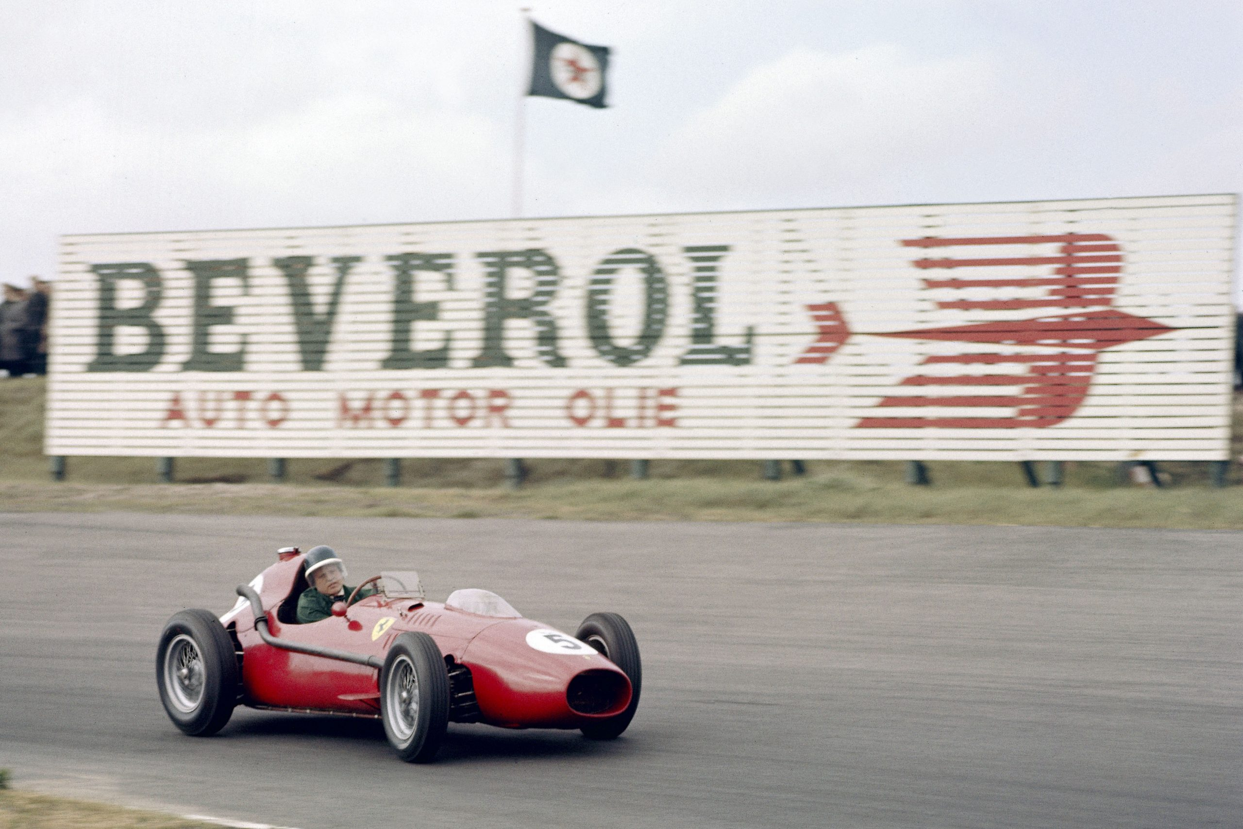 Mike hawthorn piloting his Ferrari D246.