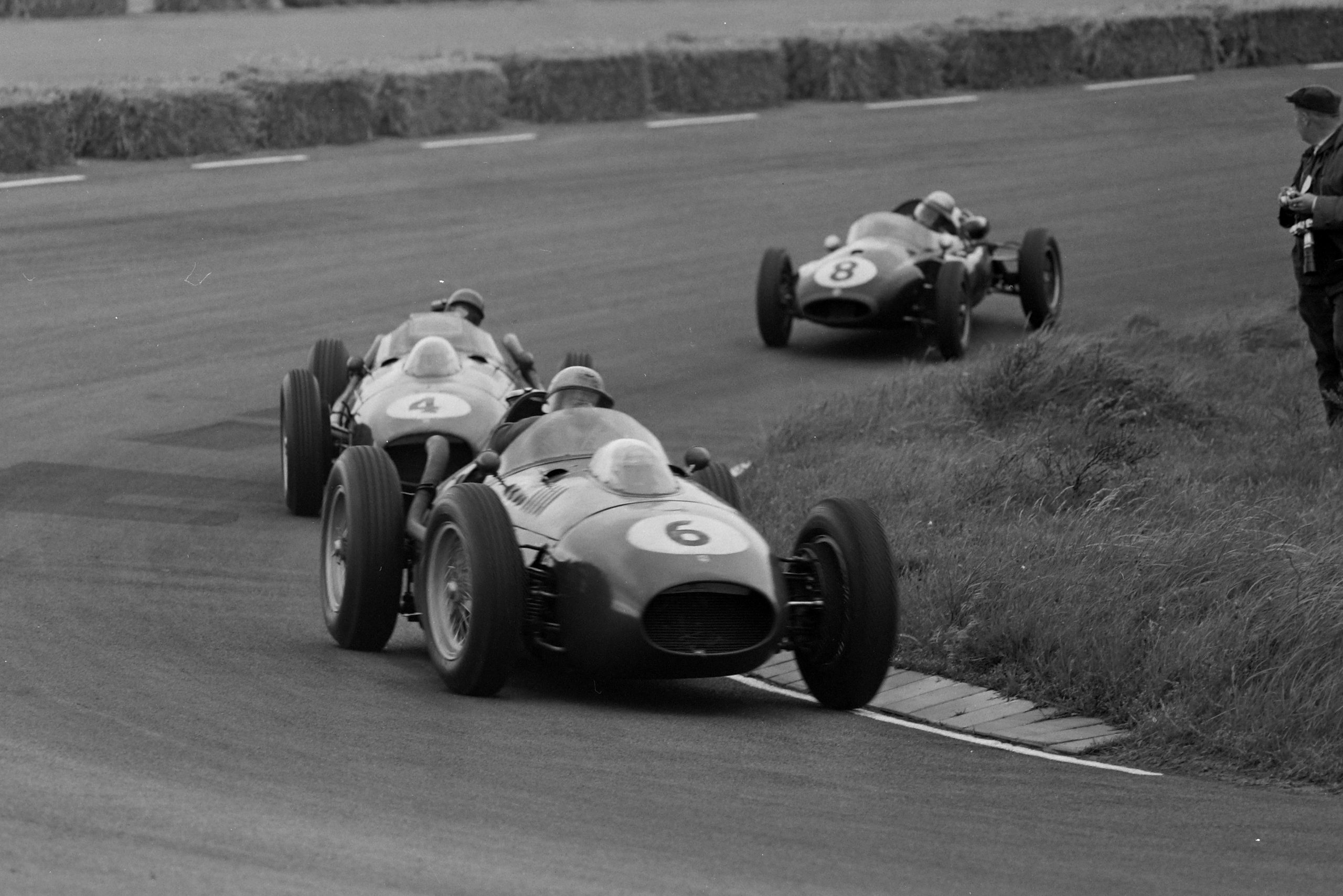 Luigi Musso in his Ferrari 246, leads Peter Collins also in a Ferrari 246, and Jack Brabham in his Cooper T45 Climax.
