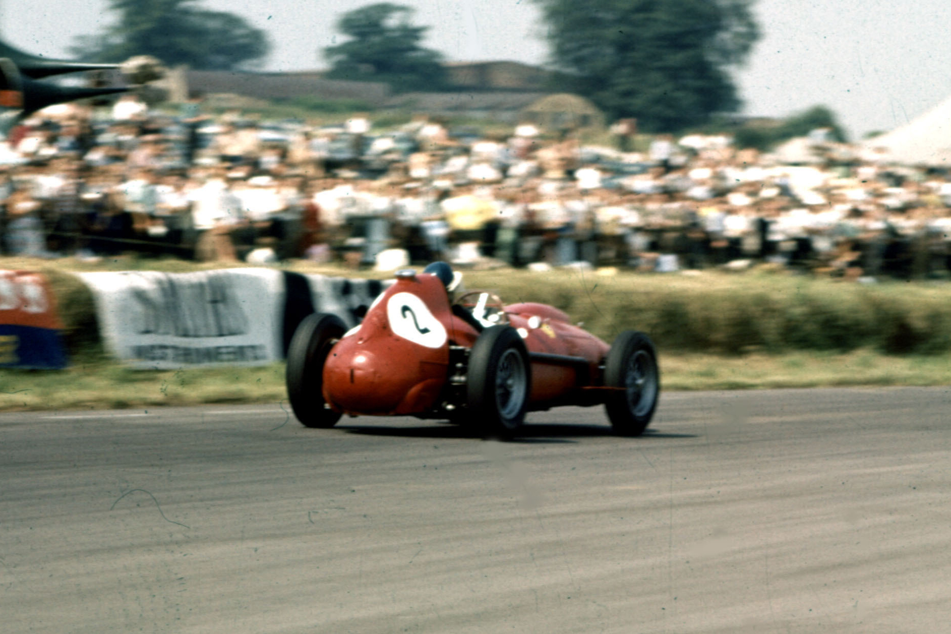 Mike Hawthorn piloting his Ferrari Dino 246 to 2nd place.