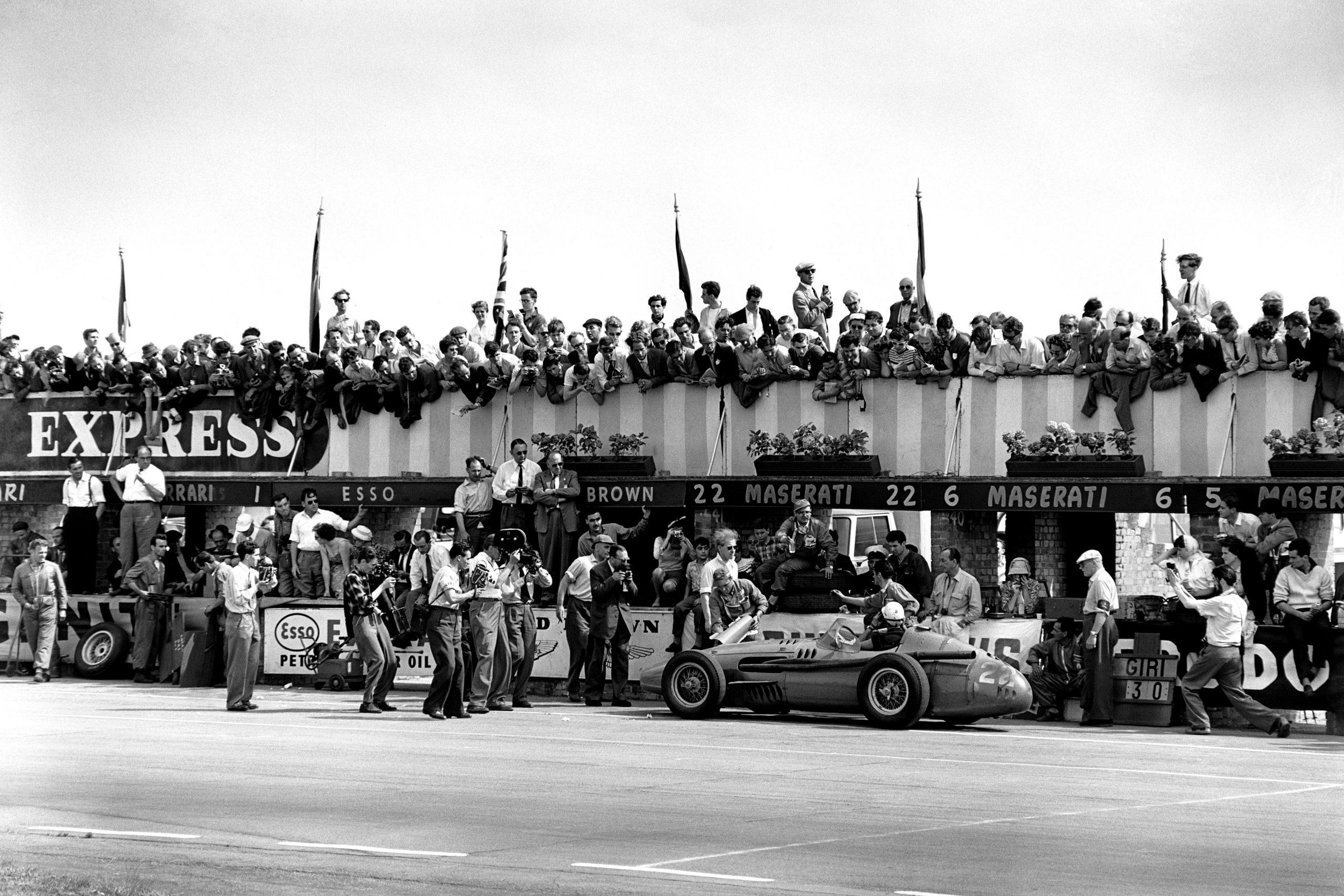 Jo Bonnier pulls into the pits in his Maserati 250F.