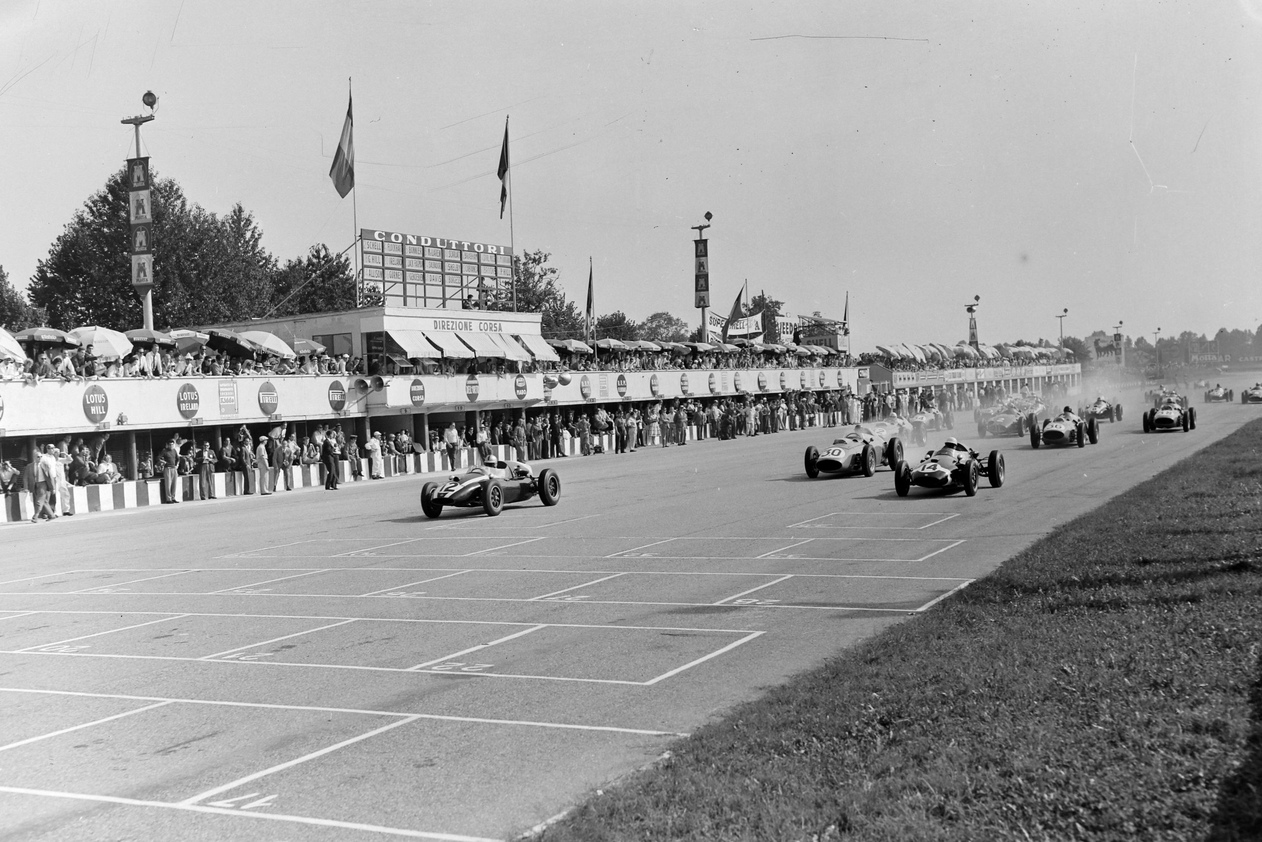 Jack Brabham (Cooper T51 Climax) leads Stirling Moss (Cooper T51 Climax) and Tony Brooks (Ferrari 246) at the start of the Italian GP at Autodromo Nazionale Monza.