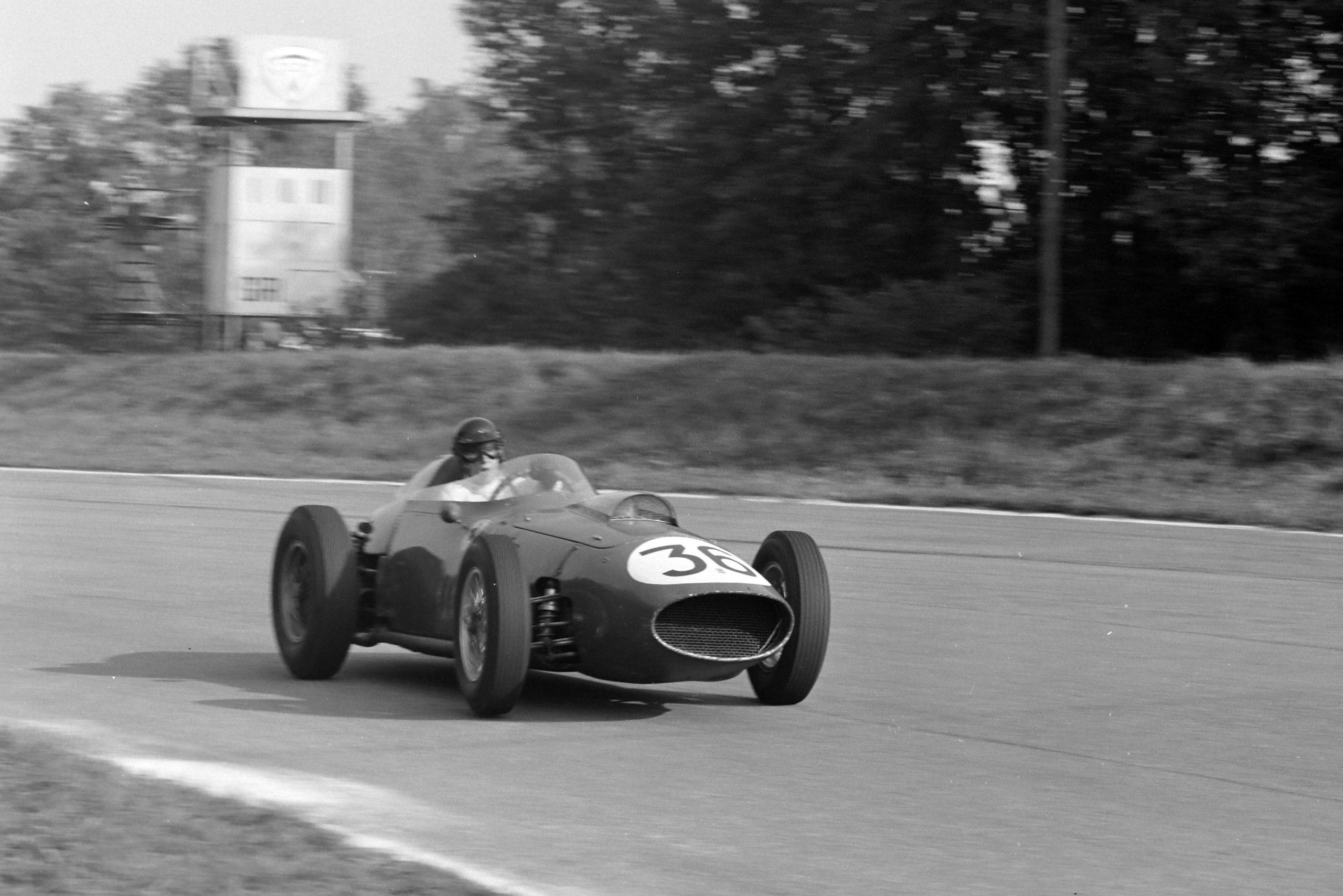 Dan Gurney driving a Ferrari 246.