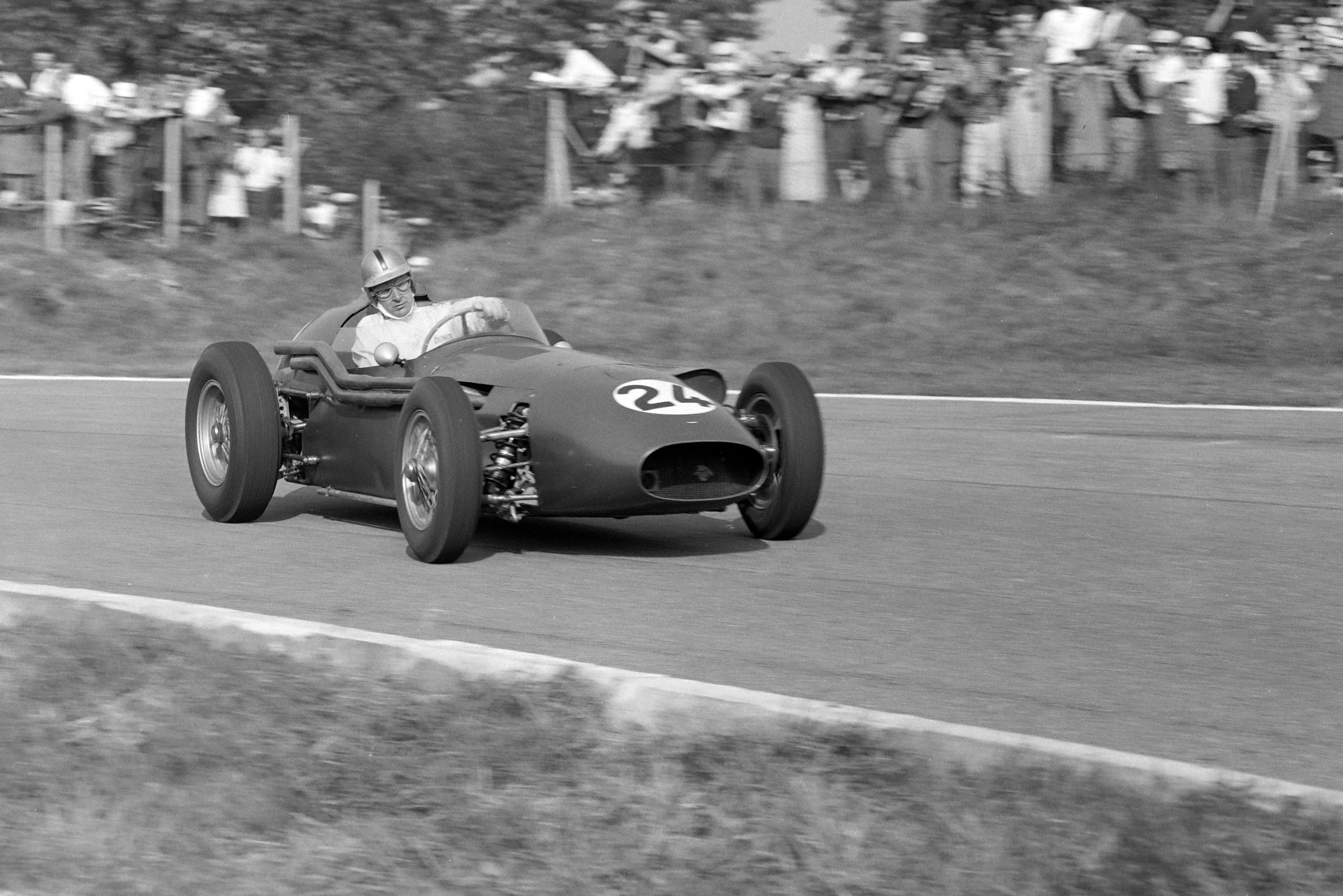 Roy Salvadori at the wheel of his Aston Martin DBR4/250